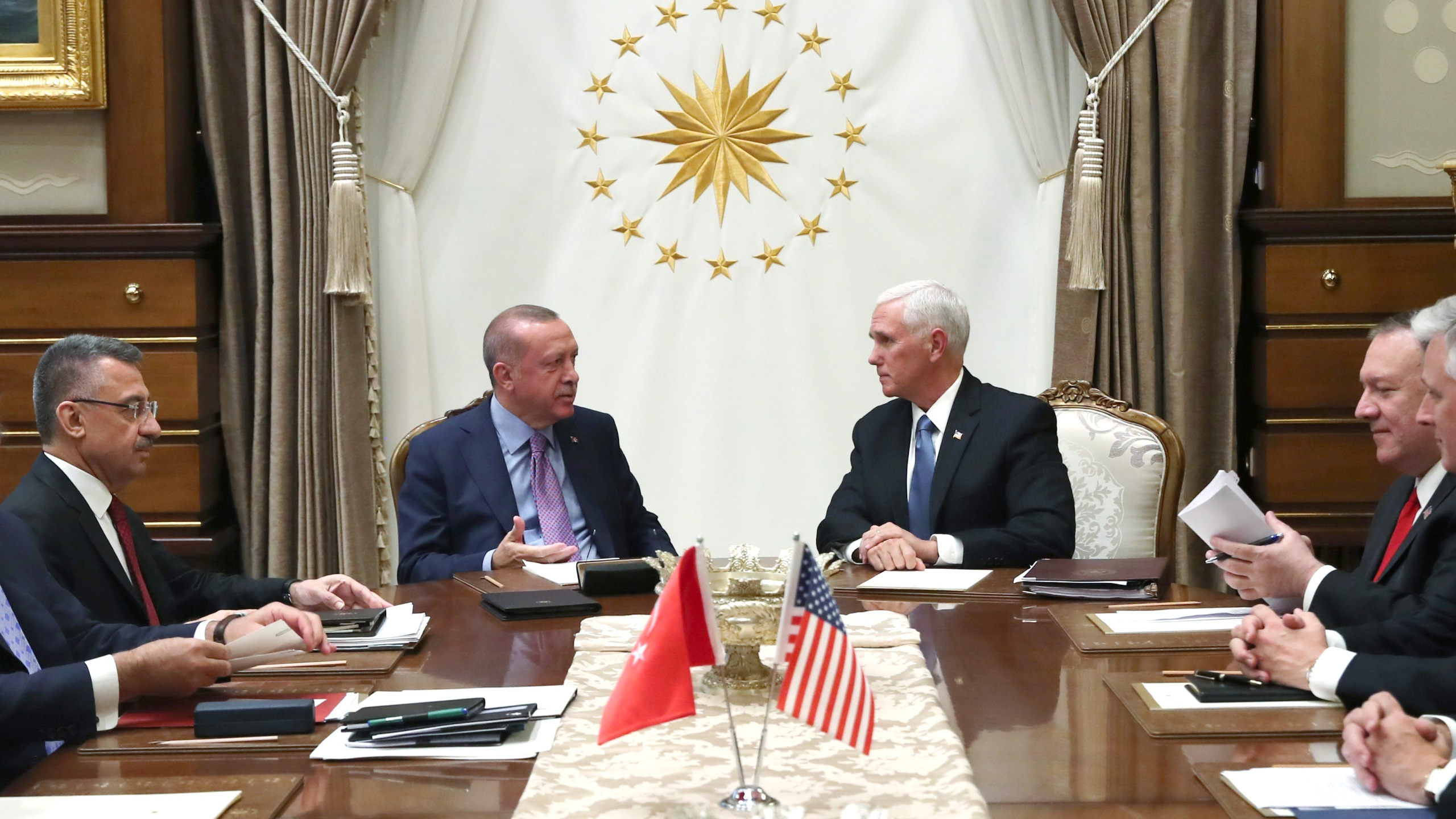 In this handout image provided by the Turkish presidency, Turkish President Recep Tayyip Erdogan meets with U.S. Vice President Mike Pence and Secretary of State Mike Pompeo at Presidential Complex in Ankara, Turkey on Oct. 17, 2019. (Credit: Murat Kula/Turkish Presidency via Getty Images)