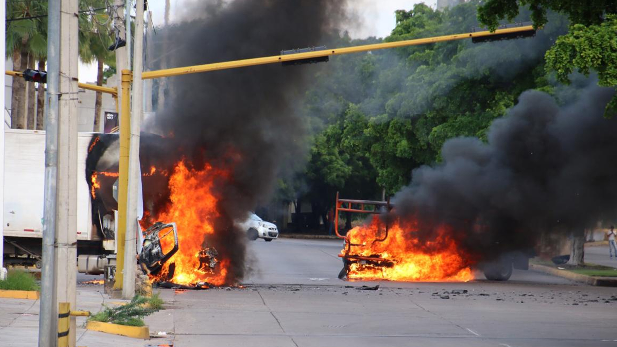 Vehicles burn in a street of Culiacan in Sinaloa state, Mexico, on Oct. 17, 2019.(Credit: STR / AFP via Getty Images)