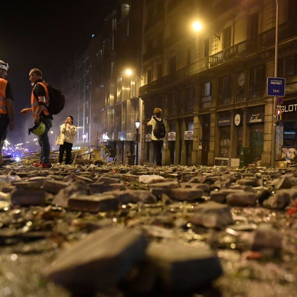 Debris is seen on a street of Barcelona, on Oct. 18, 2019, after violence escalated during clashes, with radical separatists hurling projectiles at police, who responded with teargas and rubber bullets sparking scenes of chaos in the city centre.(Credit: JOSEP LAGO/AFP via Getty Images)