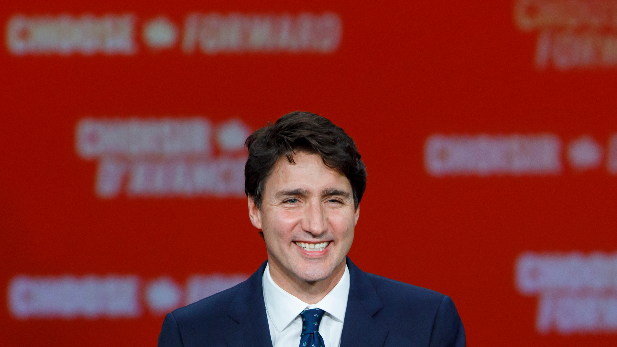 Prime Minister Justin Trudeau smiles as he delivers his victory speech at his election night headquarters on Oct. 21, 2019 in Montreal, Canada. (Credit: Cole Burston/Getty Images)