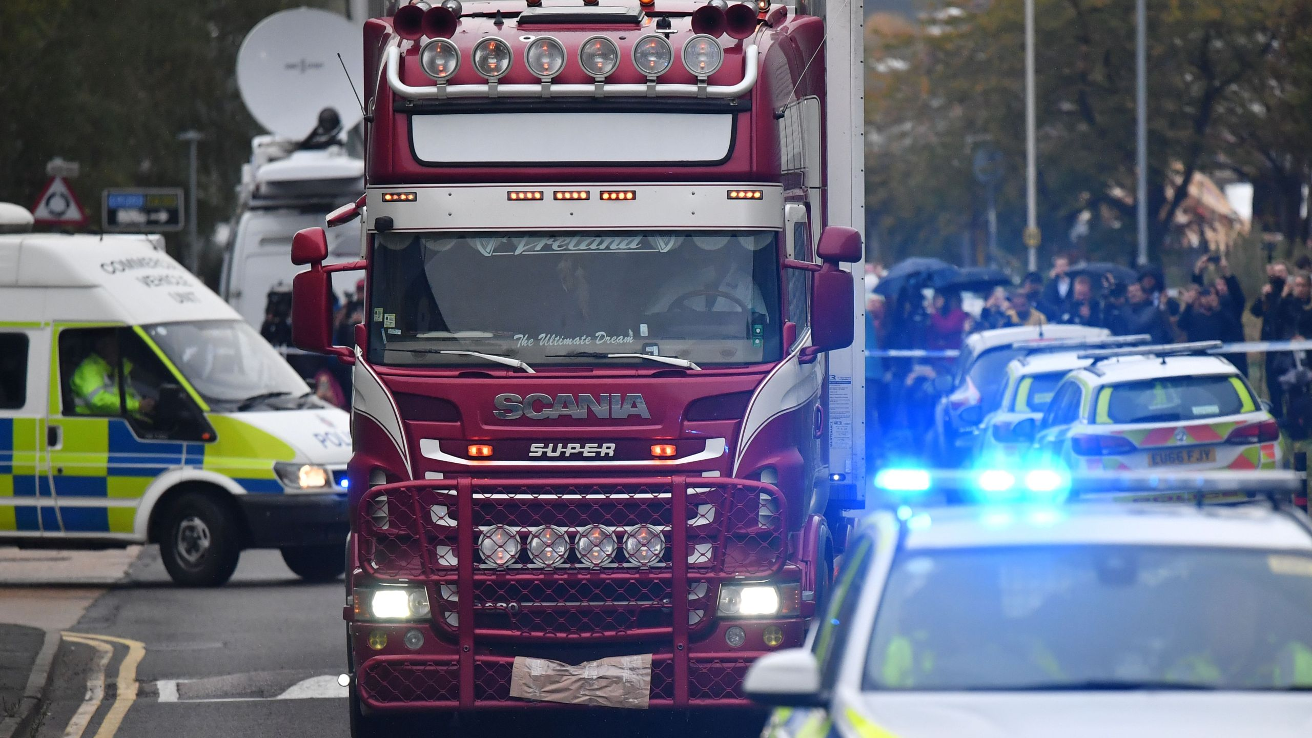 Police officers drive away a lorry in which 39 dead bodies were discovered, sparking a murder investigation at Waterglade Industrial Park in Grays, east of London, on Oct. 23, 2019. (Credit: Ben Stansall/AFP via Getty Images)