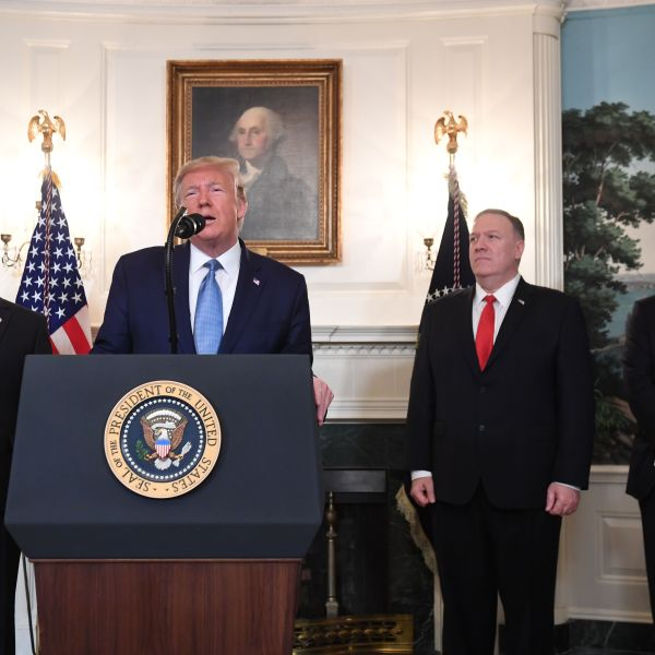 President Donald Trump discusses Syria at the White House in Washington, D.C., on Oct. 23, 2019 as Vice President Mike Pence, Secretary of State Mike Pompeo and National Security adviser Robert OBrien look on. (Credit: SAUL LOEB/AFP via Getty Images)