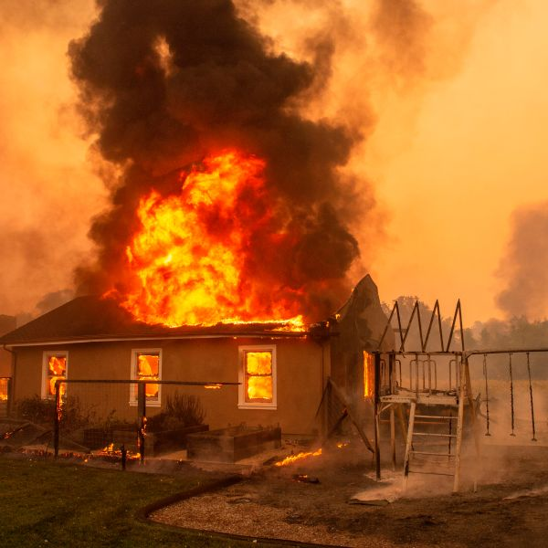 A home burns at a vineyard during the Kincade fire near Geyserville, California on Oct. 24, 2019. (Credit: Josh Edelson/AFP via Getty Images)