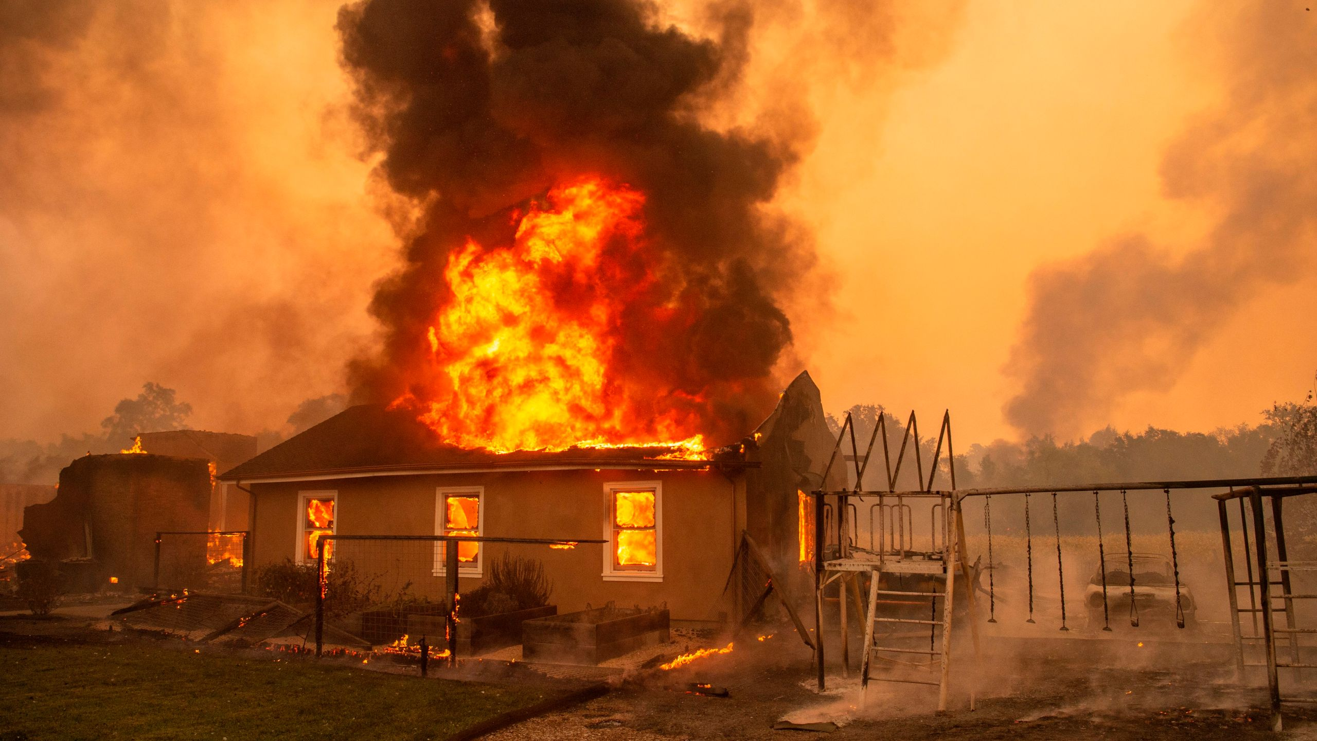 A home burns at a vineyard during the Kincade fire near Geyserville, California on Oct. 24, 2019.(Credit: Josh Edelson/AFP via Getty Images)