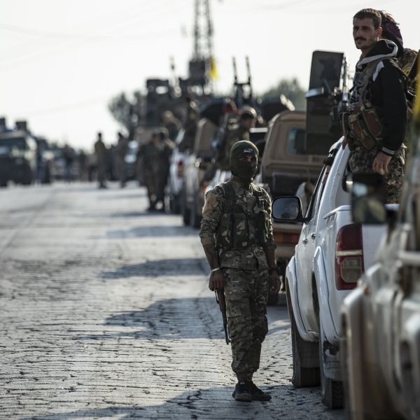 Fighters from the Syrian Democratic Forces gather in their military vehicles as they withdraw from the Sanjak Saadoun border area near the northern Syrian town of Amuda, on Oct. 27, 2019. (Credit: SOULEIMAN/AFP via Getty Images)