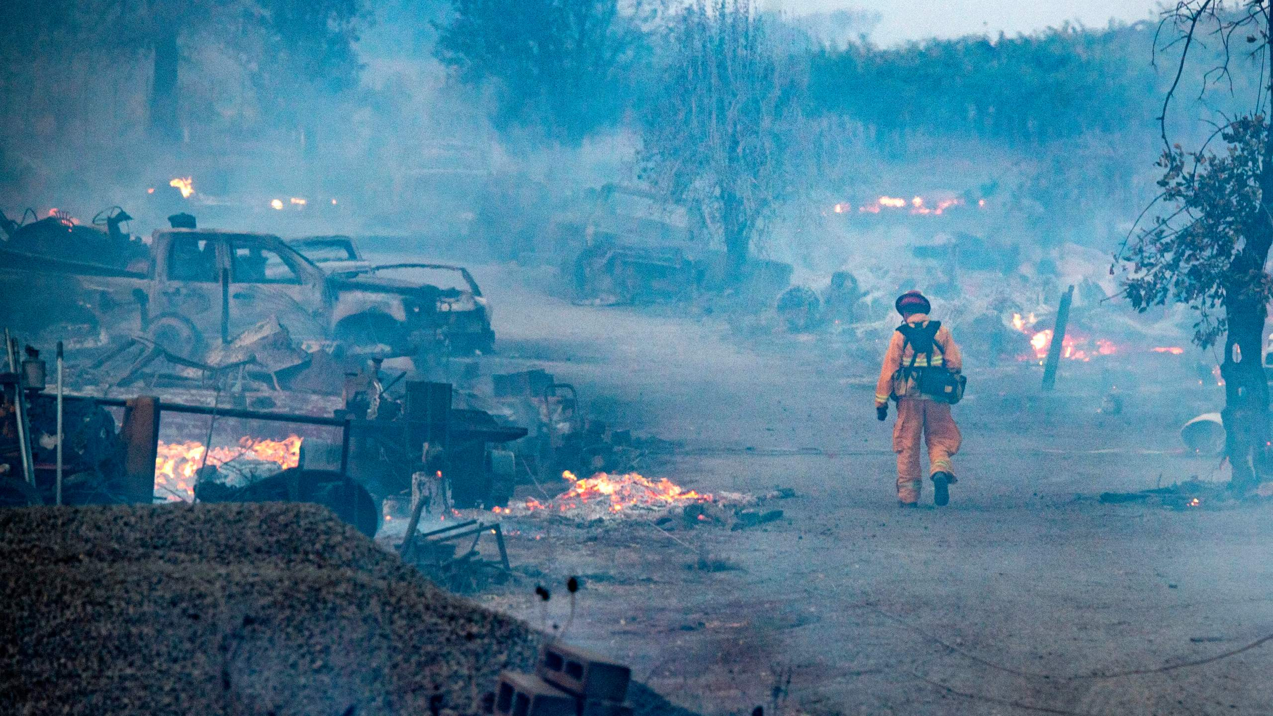 A firefighter walks through a burned property after the Kincade fire tore through Healdsburg, California on Oct. 27, 2019. (Credit: JOSH EDELSON/AFP via Getty Images)