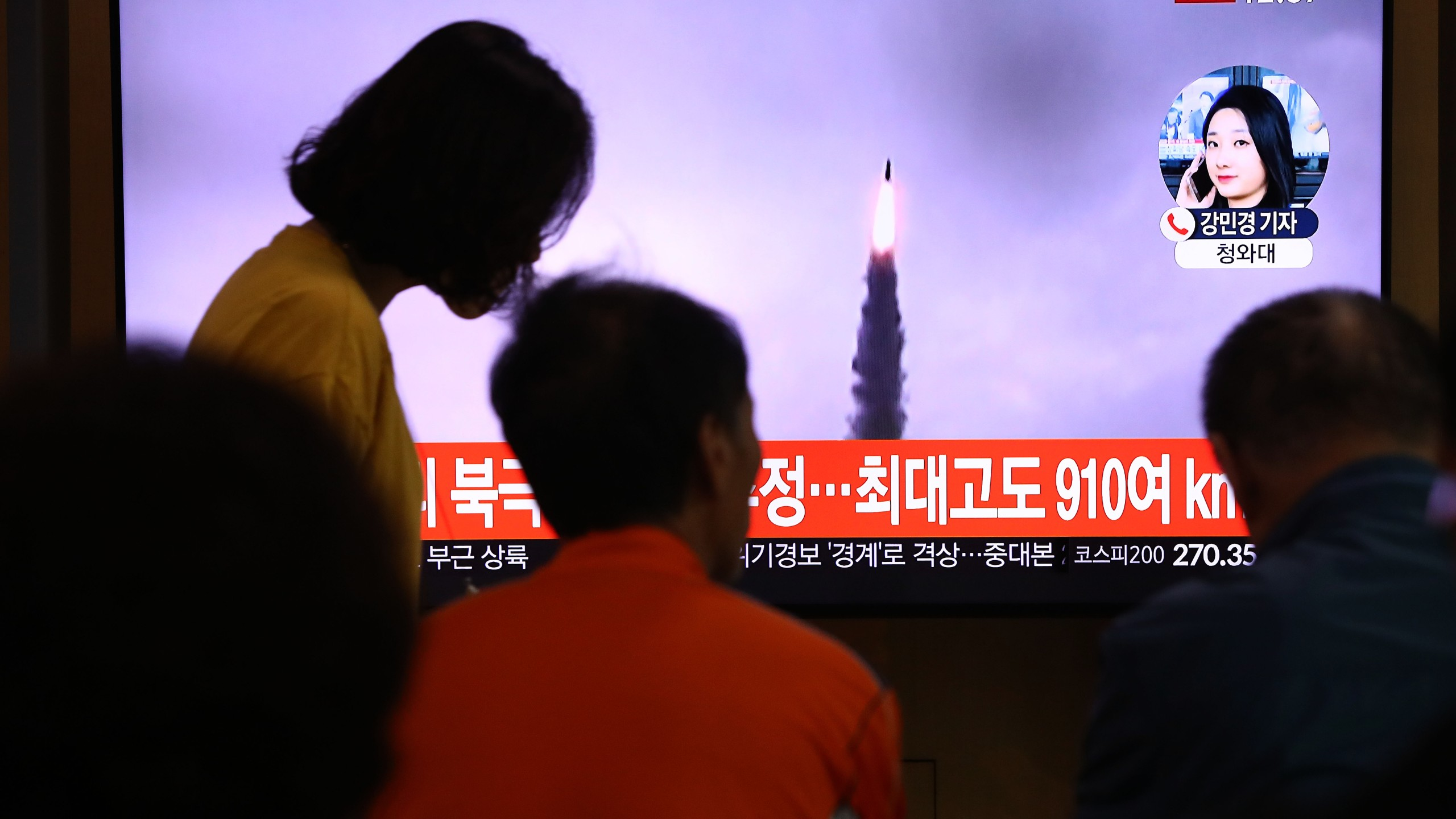 People watch a TV showing a file image of a North Korean missile launch at the Seoul Railway Station on Oct. 2, 2019, in Seoul, South Korea. (Credit: Chung Sung-Jun/Getty Images)
