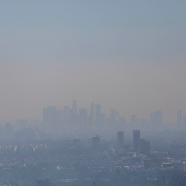 The Los Angeles skyline is seen through smoke as the Getty fire burns in the Brentwood area on Oct. 28, 2019. (Credit: APU GOMES/AFP via Getty Images)