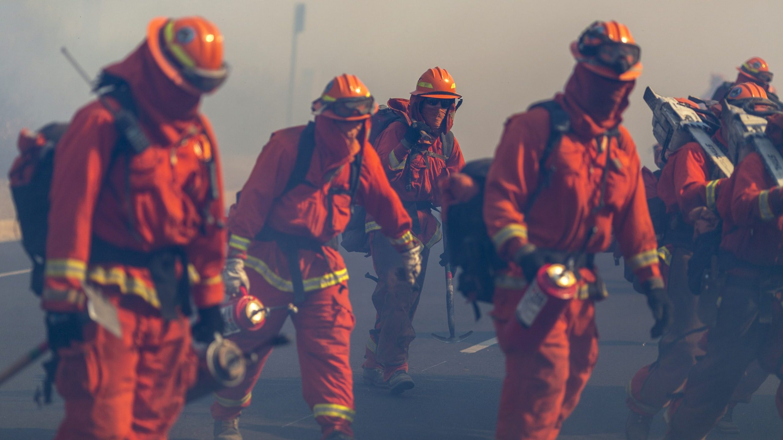 Inmate firefighters from Oak Glen Conservation Camp near Yucaipa, California fight the Easy Fire on Oct. 30, 2019, near Simi Valley. (Credit: David McNew/Getty Images)
