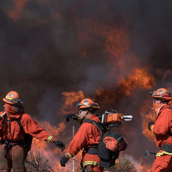 Inmate firefighters prepare to put out flames on the road leading to the Reagan Library during the Easy Fire in Simi Valley, California on October 30, 2019. (Credit: Mark Ralston/AFP via Getty Images)