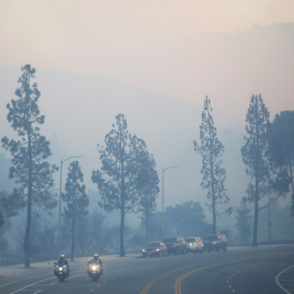 Smoke from the Saddleridge Fire rises on Oct. 11, 2019 near Porter Ranch. (Credit: Mario Tama/Getty Images)