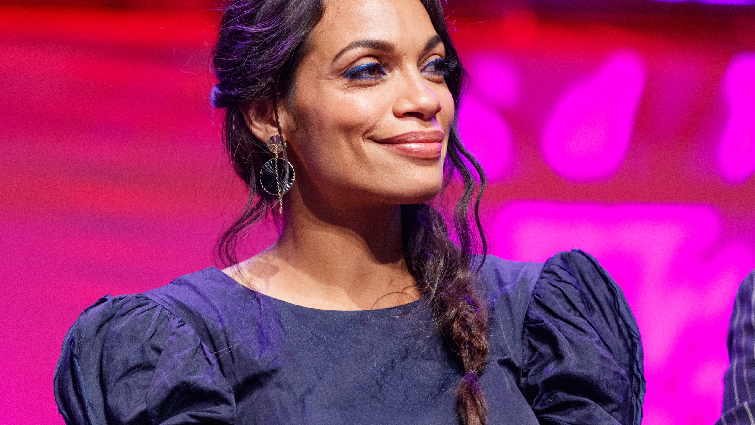 """Actress Rosario Dawson appears on stage at a """"Zombieland 2"""" panel and screening at the Los Angeles Convention Center on Oct. 12, 2019. (Credit: Rich Polk / Getty Images for Sony Pictures Entertainment)"""