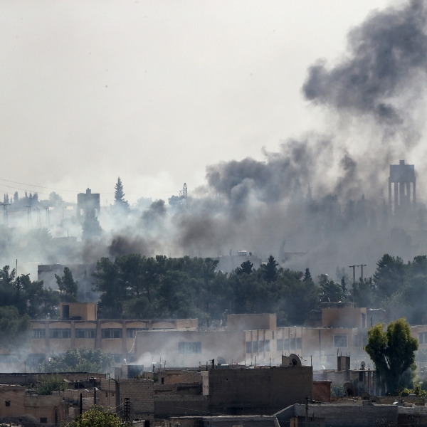 Smoke rises over the Syrian town of Tal Abyad, as seen from the Turkish border town of Akcakale on Oct. 13, 2019. (Credit: Burak Kara/Getty Images)