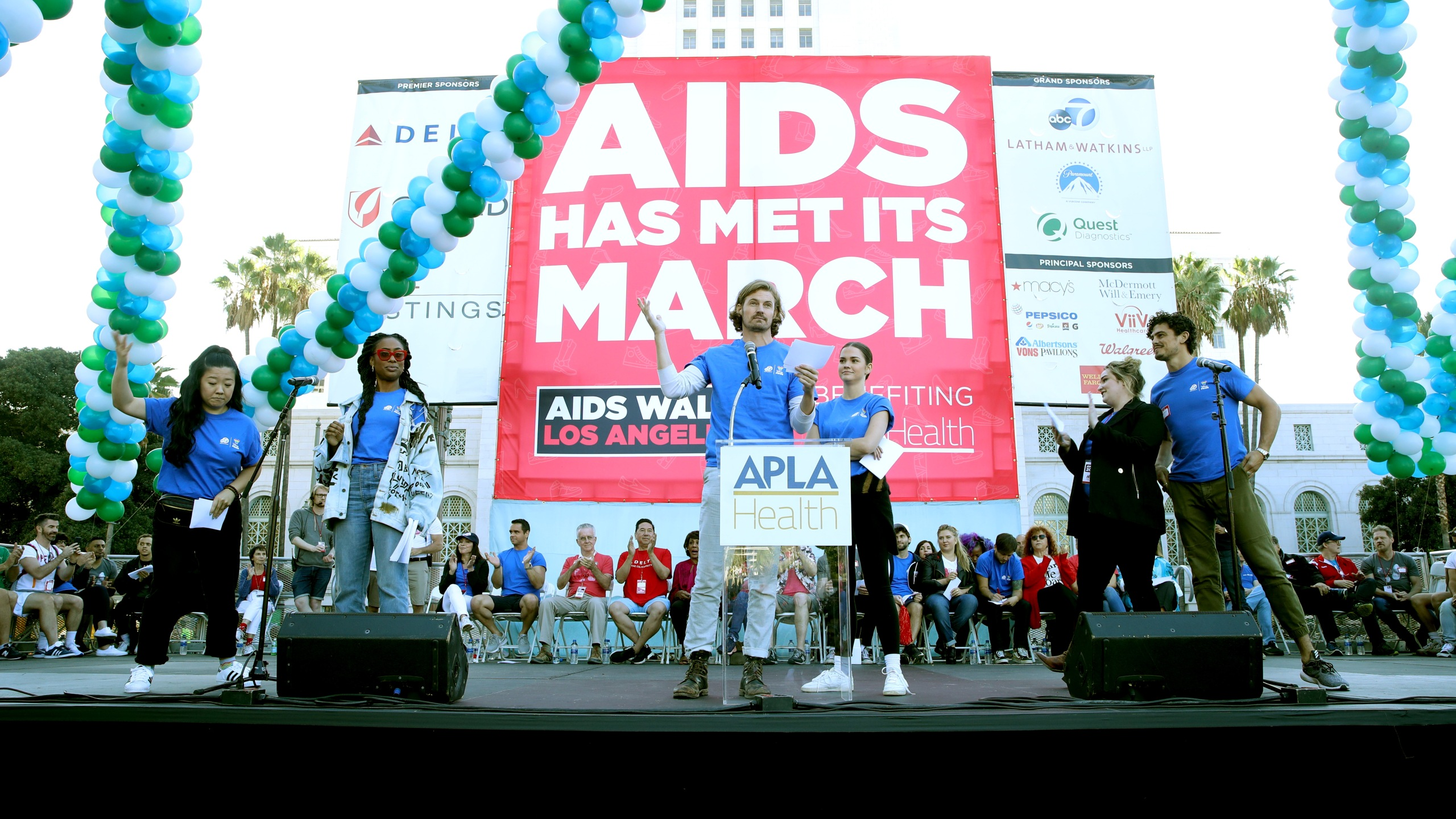 Sherry Cola, Zuri Adele, Josh Pence, Maia Mitchell, Emma Hunton and Tommy Martinez speak on stage during AIDS Walk Los Angeles on Oct. 20, 2019. (Credit: Randy Shropshire/Getty Images for AIDS Walk Los Angeles)