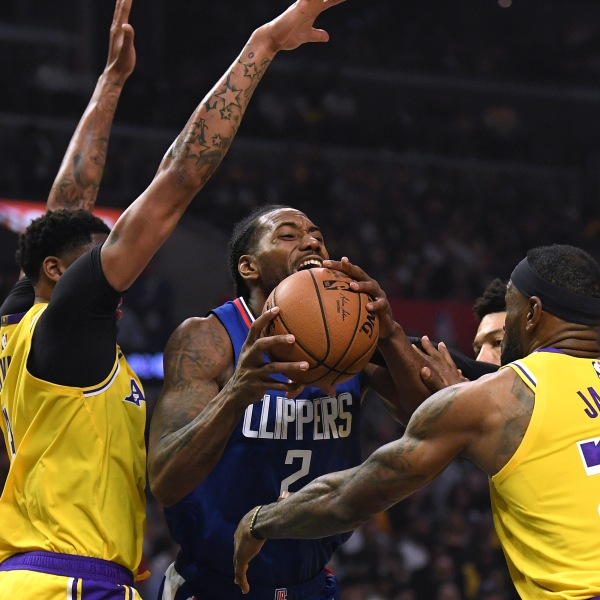 Kawhi Leonard of the L.A. Clippers is fouled by LeBron James of the L.A. Lakers as he steps by Anthony Davis during a game at Staples Center on Oct. 22, 2019. (Credit: Harry How/Getty Images)