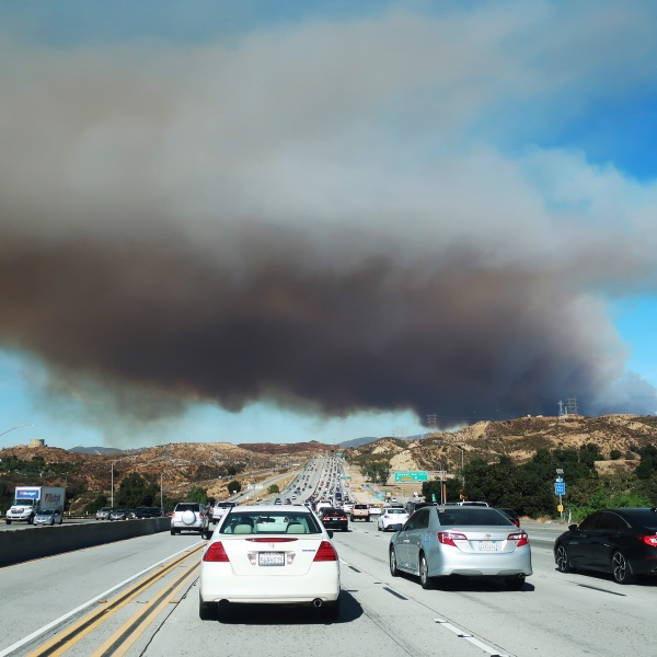 Drivers are seen as the Tick Fire burns in nearby Canyon Country on Oct. 24, 2019 in Santa Clarita. (Credit: Mario Tama/Getty Images)