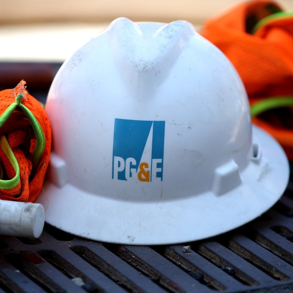 The Pacific Gas and Electric (PG&E) logo is displayed on a hard hat at a work site on July 30, 2014 in San Francisco, California. (Credit: Justin Sullivan/Getty Images)