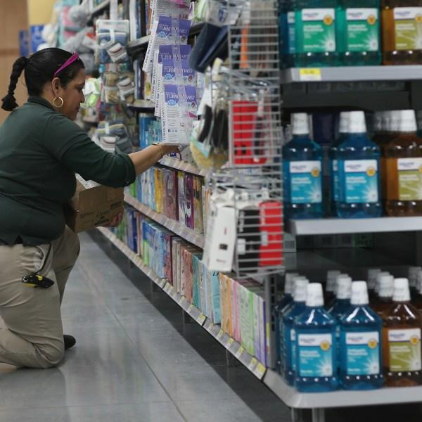 Walmart employee Clara Martinez stocks the shelves at a Walmart store on Feb. 19, 2015 in Miami, Florida. (Credit: Joe Raedle/Getty Images)