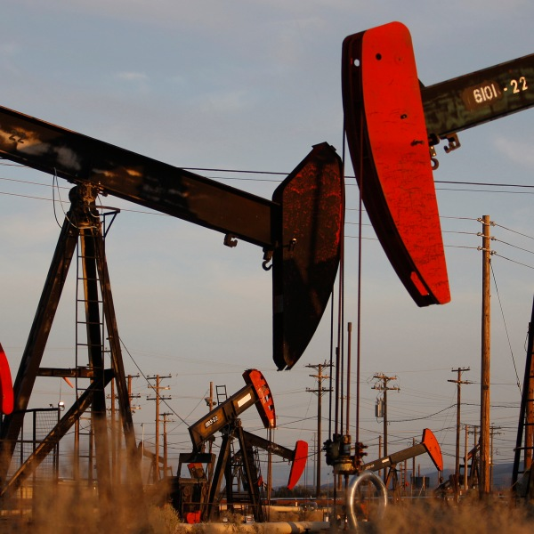 Pump jacks and wells are seen in an oil field on the Monterey Shale formation where gas and oil is extracted using hydraulic fracturing, or fracking, on March 23, 2014, near McKittrick in Kern County. (Credit: David McNew / Getty Images)
