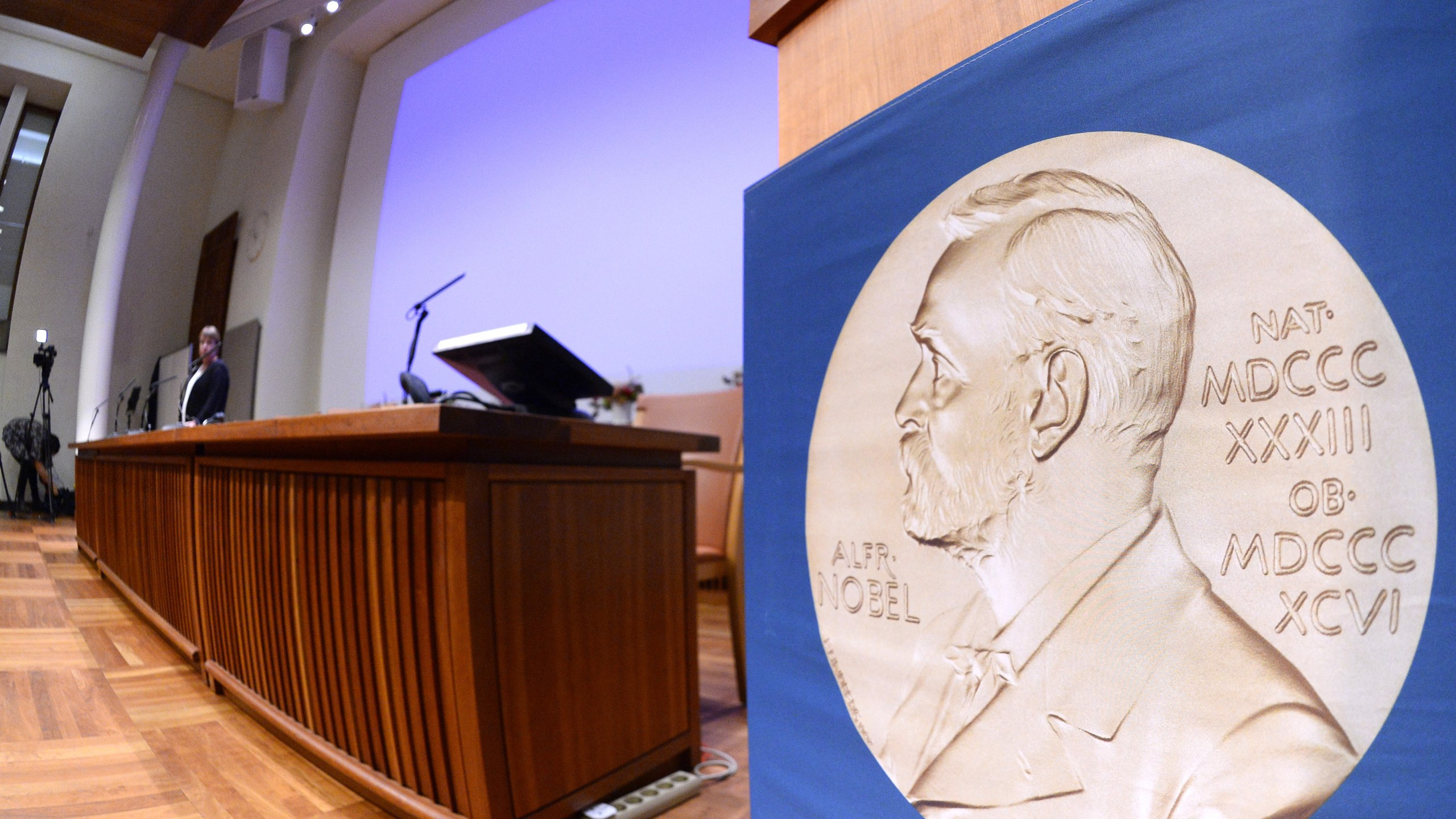 The laureate medal featuring the portrait of Alfred Nobel is seen on a sign before the Nobel Committee announced the 2015 winners on Oct. 5, 2015, in Stockholm, Sweden.(Credit: Jonathan Nackstrand/AFP/Getty Images)