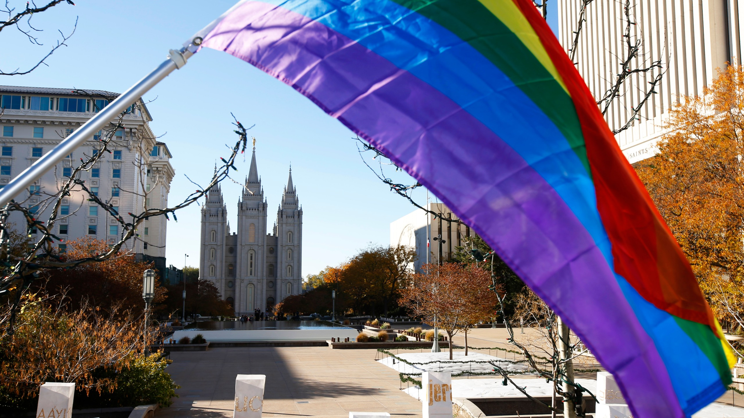 A pride flag flies in front of the Historic Mormon Temple as part of a protest where people resigned from the Church of Jesus Christ of Latter-Day Saints in response to a recent change in church policy towards married LGBTQ same-sex couples and their children on Nov. 14, 2015, in Salt Lake City, Utah. (Credit: George Frey/Getty Images)