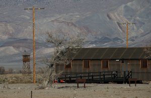 A replica of internment camp barracks sits near a watch tower at Manzanar National Historic Site on Dec. 9, 2015, near Independence, California. (Credit: Justin Sullivan/Getty Images)