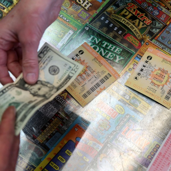 A customer buys Powerball tickets at Kavanagh Liquors on Jan. 13, 2016 in San Lorenzo, Calif. (Credit: Justin Sullivan/Getty Images)