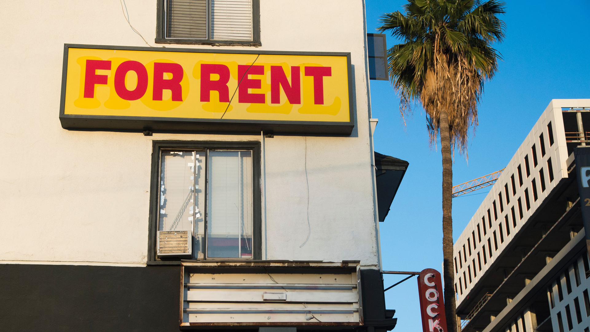 """A """"for rent"""" sign is seen on a building Hollywood on May 11, 2016. (Credit: Robyn Beck/AFP via Getty Images)"""