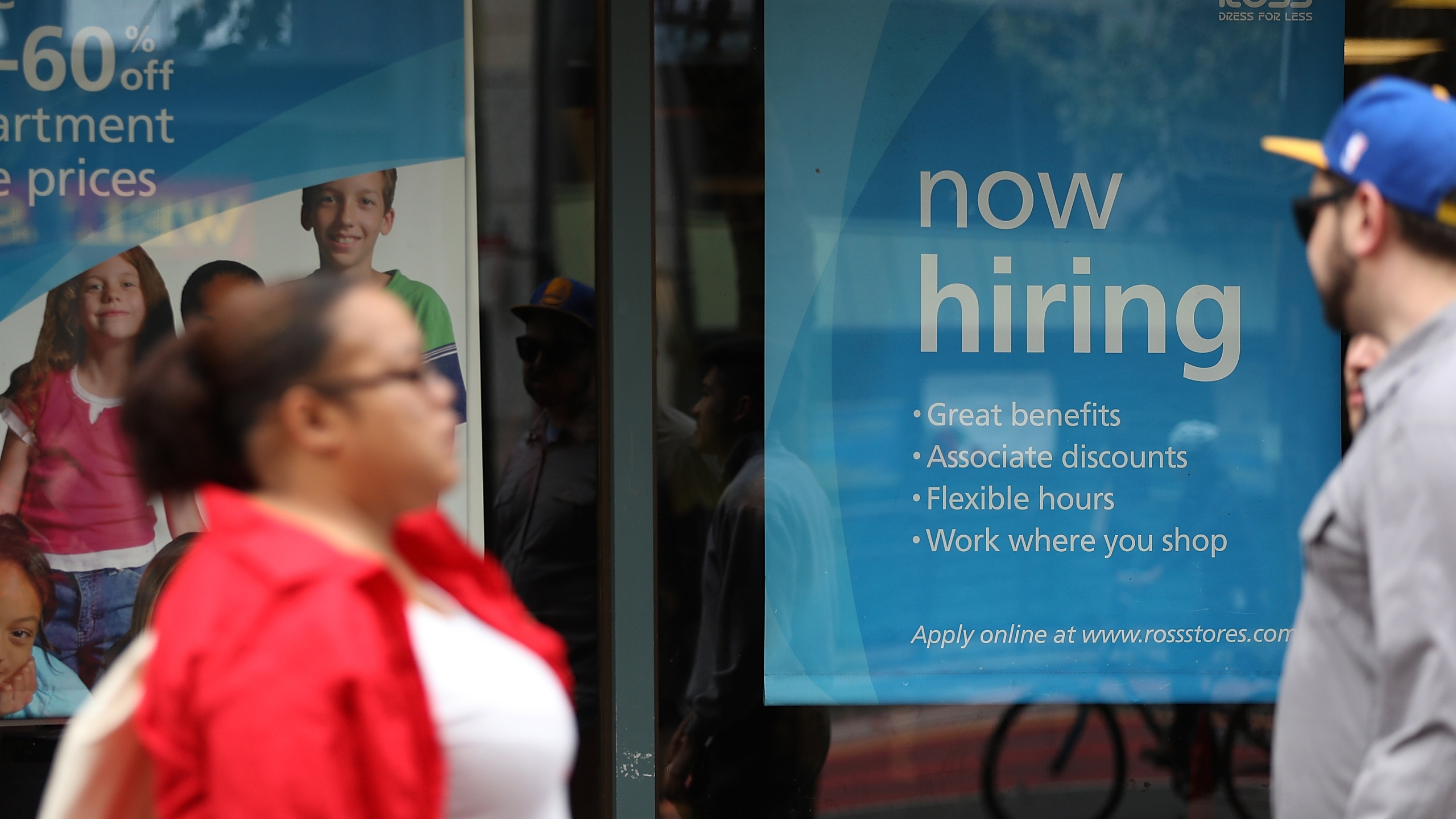 "A ""now hiring"" sign is posted outside of a Ross Dress for Less store on July 8, 2016 in San Francisco. (Credit: Justin Sullivan/Getty Images)"