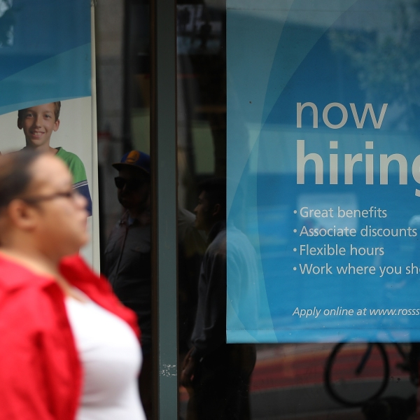 """A """"now hiring"""" sign is posted outside of a Ross Dress for Less store on July 8, 2016 in San Francisco. (Credit: Justin Sullivan/Getty Images)"""