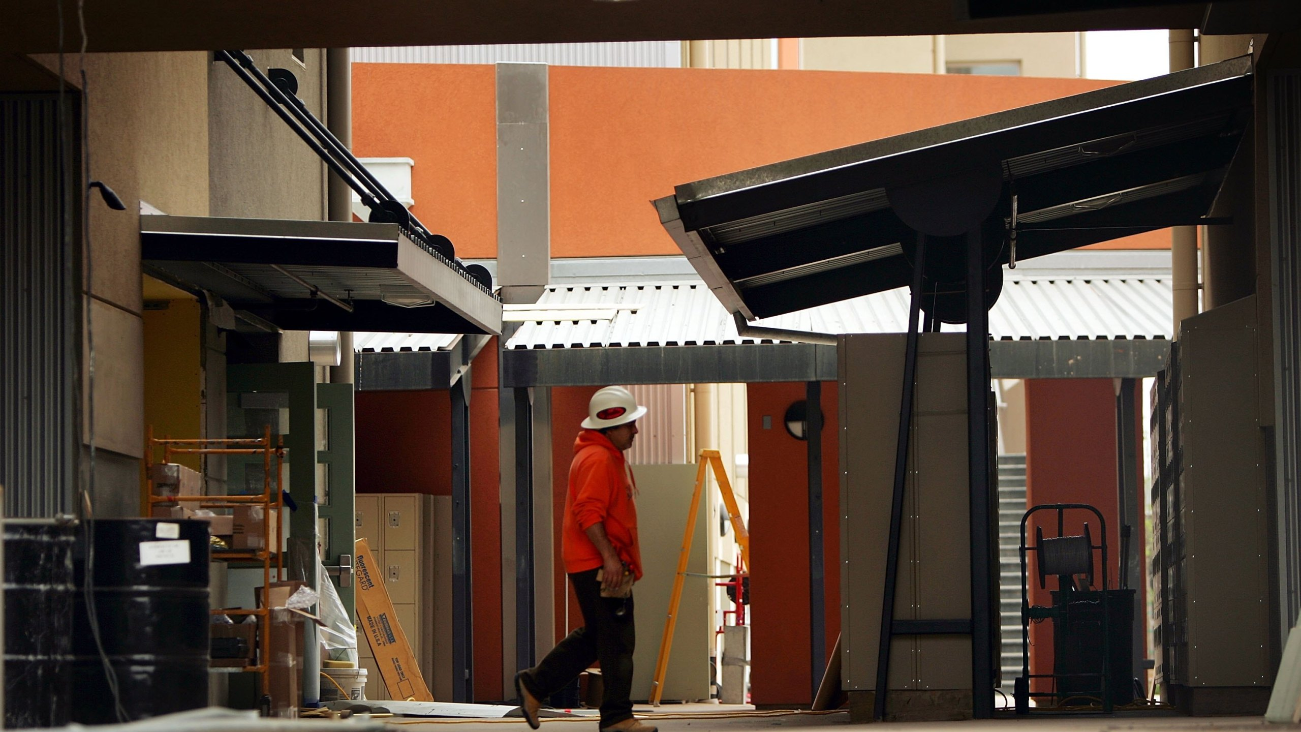 A worker walks through a school under construction in Maywood on May 17, 2006. (Credit: David McNew/Getty Images)