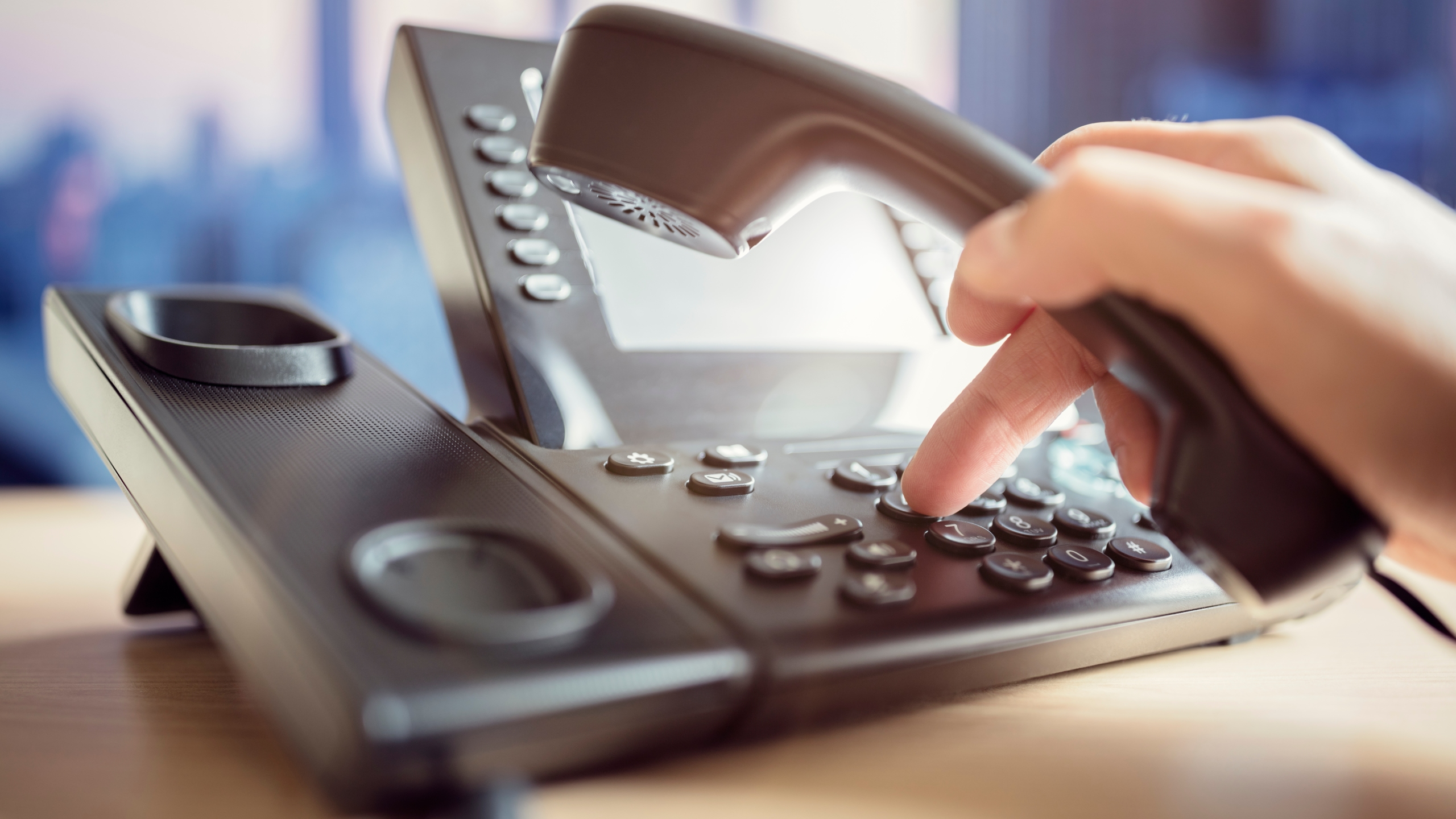 Someone is seen dialing to make a telephone call in this file photo. (Credit: iStock / Getty Images Plus)