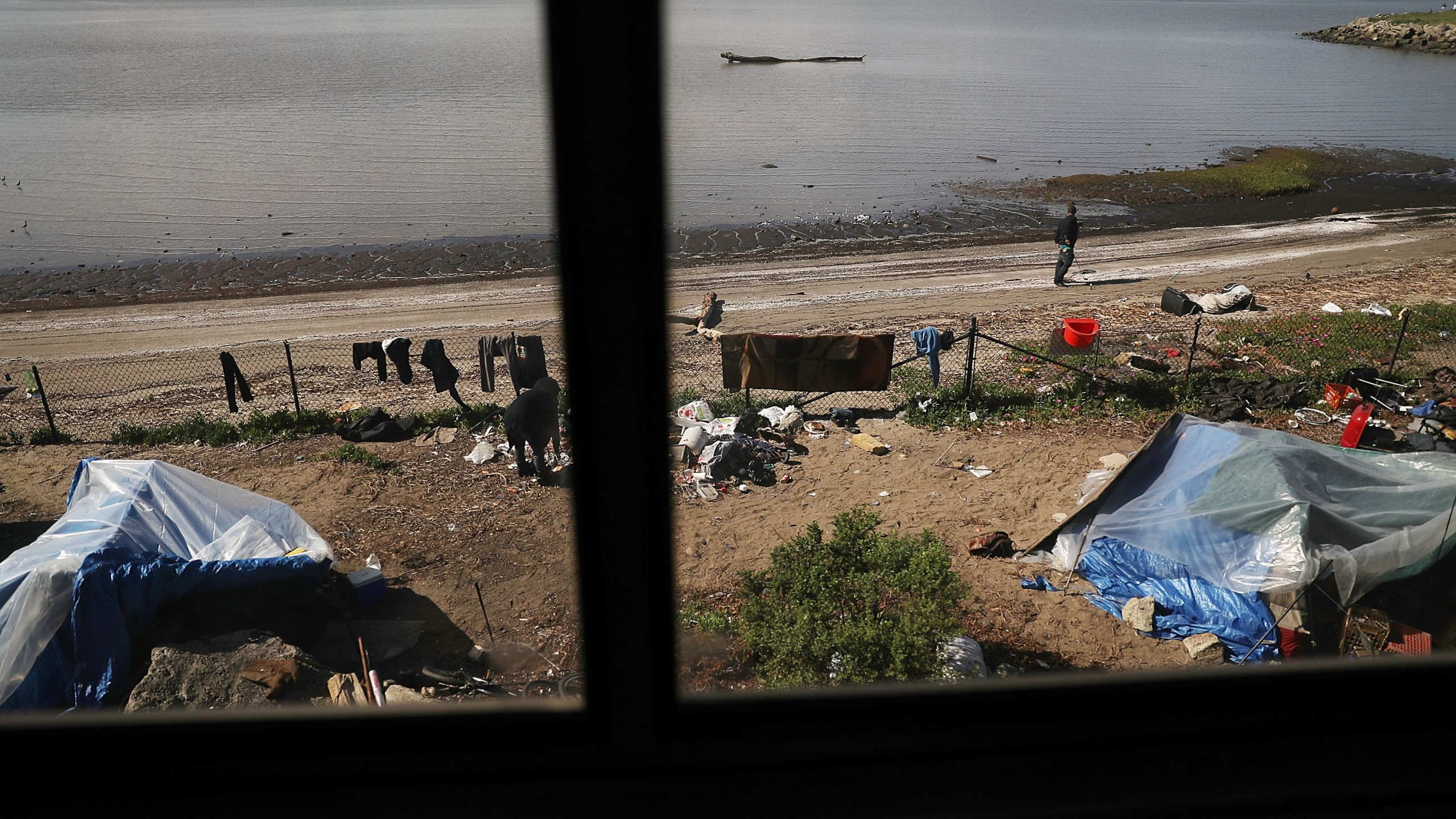 A homeless encampment is seen as Amtrak's California Zephyr passes along San Pablo Bay as it nears Emeryville on March 25, 2017. (Credit: Joe Raedle / Getty Images)