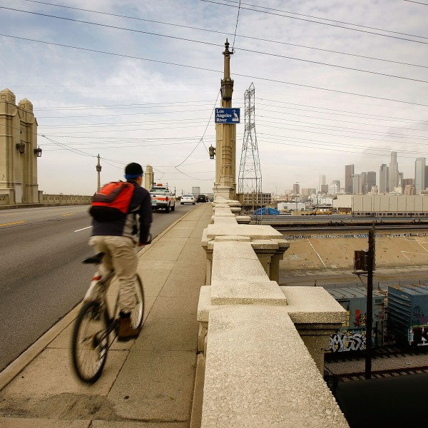 A bicyclist crosses the Fourth Street Bridge over the Los Angeles River Feb. 21, 2008, in Los Angeles, California. (Credit: David McNew/Getty Images)