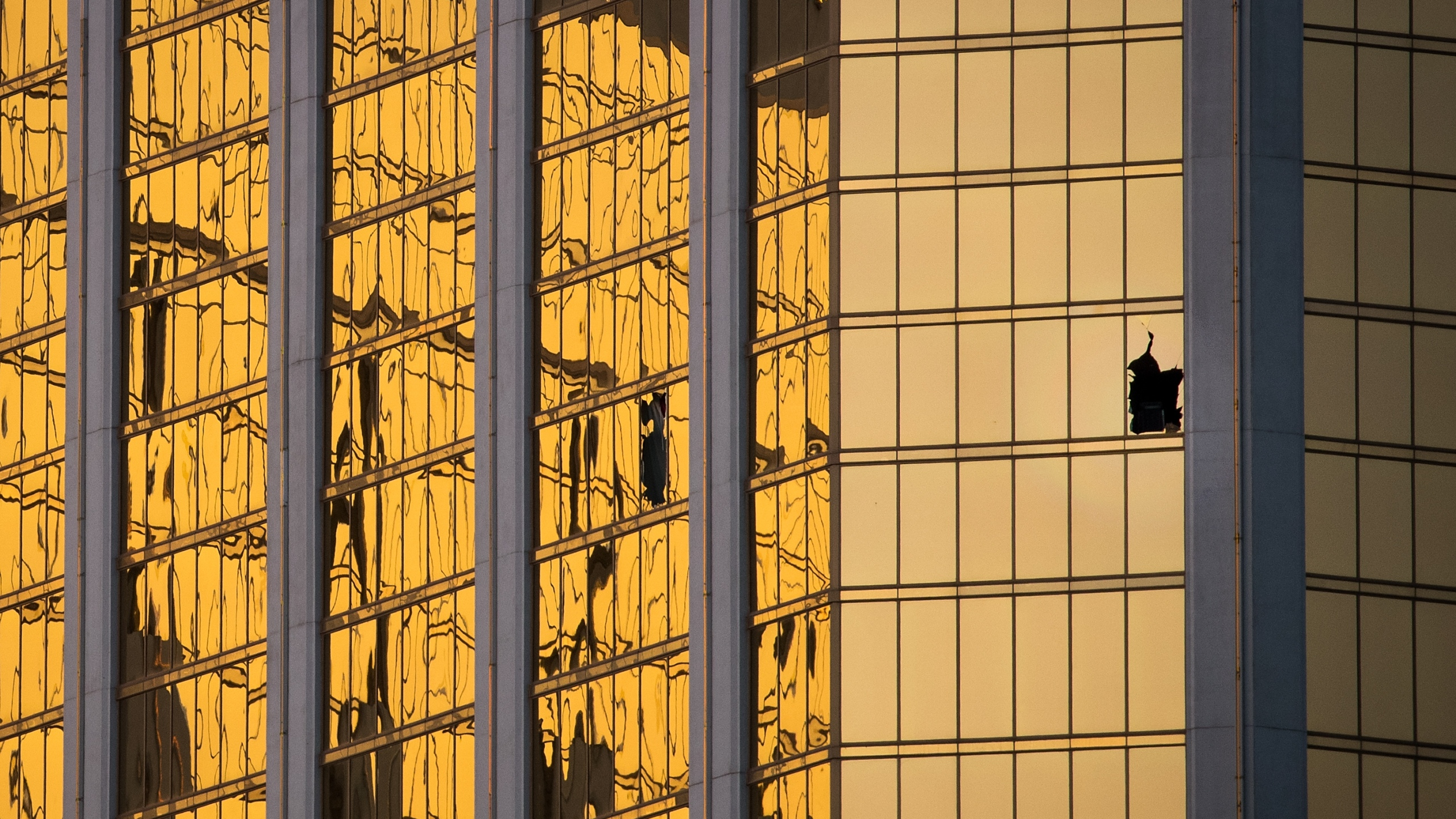 A window is broken on the 32nd floor of the Mandalay Bay Resort and Casino where a gunman opened fire on a concert crowd on Sunday night, October 3, 2017 in Las Vegas, Nevada. (Credit: Drew Angerer/Getty Images)
