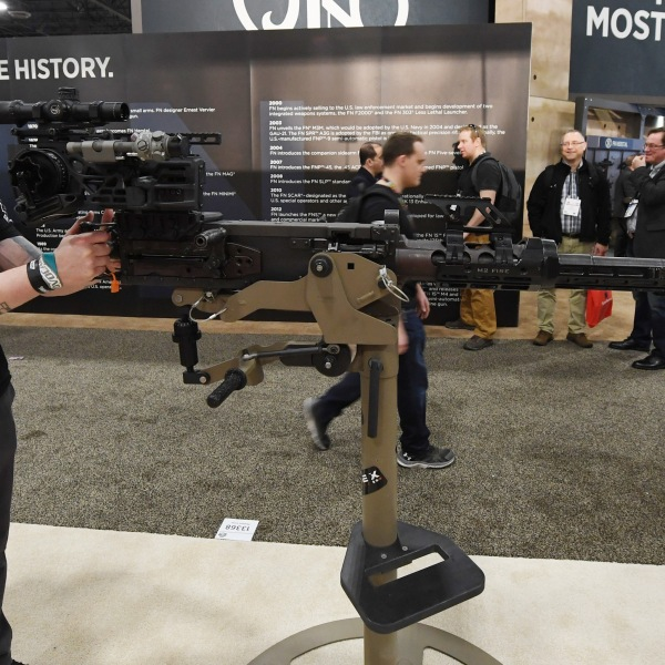 Kenneth Conkright of Colorado looks at a .50-caliber M2 machine gun at a 2018 trade show in Las Vegas.(Credit: Ethan Miller/Getty Images)