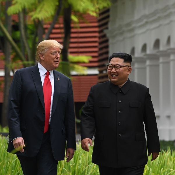 North Korea's leader Kim Jong Un (R) walks with US President Donald Trump (L) during a break in talks at their historic US-North Korea summit, at the Capella Hotel on Sentosa island in Singapore on June 12, 2018. (Credit: SAUL LOEB/AFP/Getty Images)