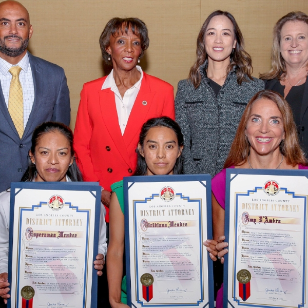 (Left to right, bottom row:) Esperanza Mendez of Los Angeles, Virdiana Mendez of Los Angeles, Amy D'Ambra of Rolling Hills and Joel Ortuno Jr. of Anaheim (not pictured) were honored by Los Angeles County District Attorney Jackie Lacey for acts of courage on Oct. 4, 2019. (Credit: Los Angeles County District Attorney's Office)