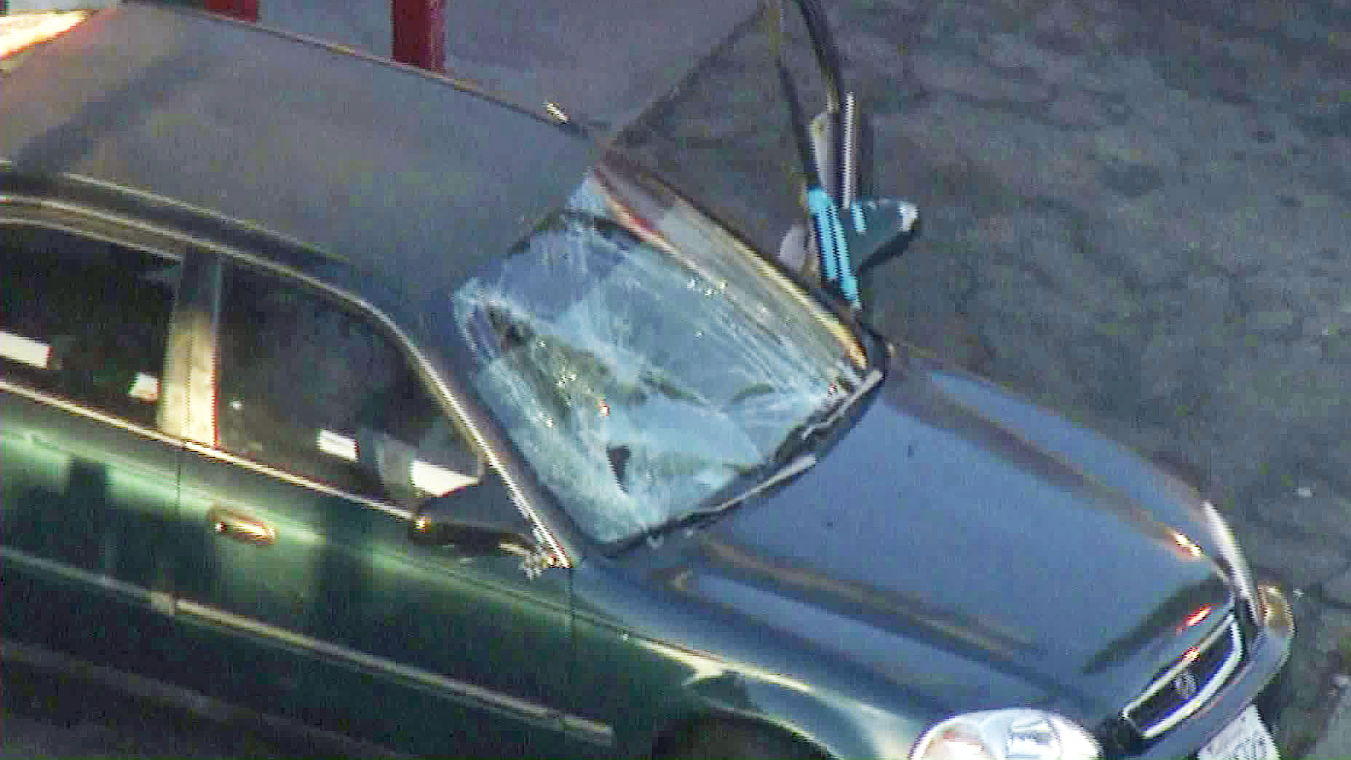 A damaged vehicle is left at the scene of a hit-and-run crash in South Los Angeles. (Credit: KTLA)