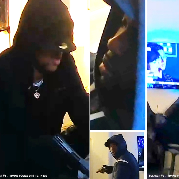 Two men sought in a home invasion robbery and shooting are shown in surveillance video released by the Irvine Police Department on Oct. 28, 2019.