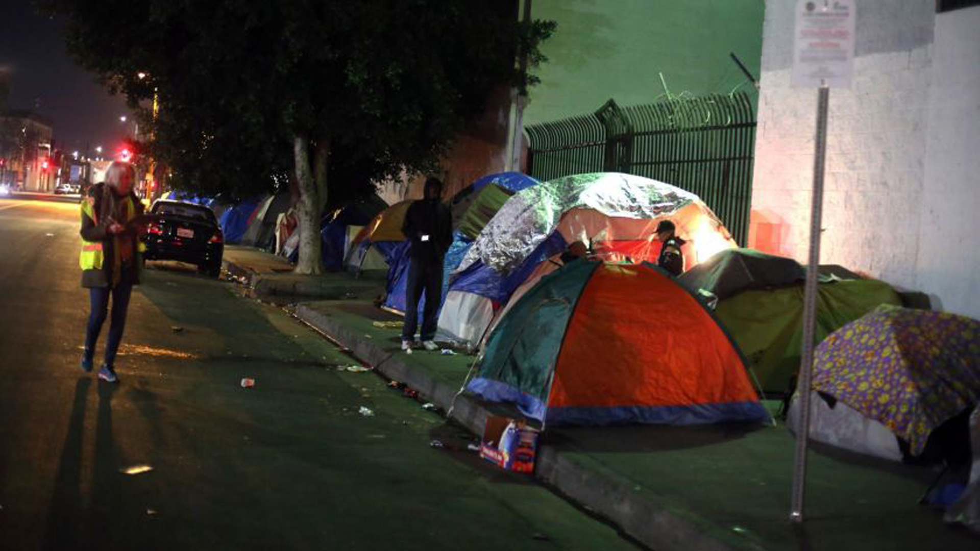 Volunteer Barbara Petersmeyer, left, looks at tents during this year's point-in-time count, run by the Los Angeles Homeless Services Authority.(Credit: Dania Maxwell / Los Angeles Times)