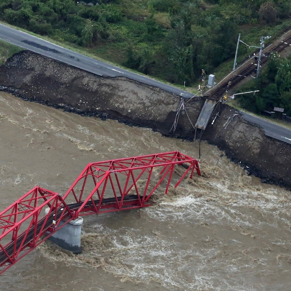 This aerial view shows a damaged train bridge over the swollen Chikuma river in the aftermath of Typhoon Hagibis in Ueda, Nagano prefecture on October 13, 2019. (Credit: STR/JIJI PRESS/AFP/Getty Images)
