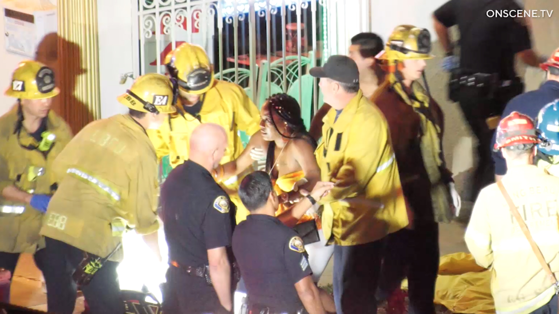 First responders assist a woman injured during a shooting at a house party in Long Beach on Oct. 29, 2019. (Credit: OnScene.TV)