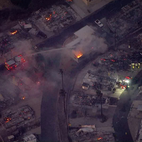 Devastation surrounds a smoldering residence after a fire destroyed much of a Calimesa mobile home park on Oct. 10, 2019. (Credit: KTLA)