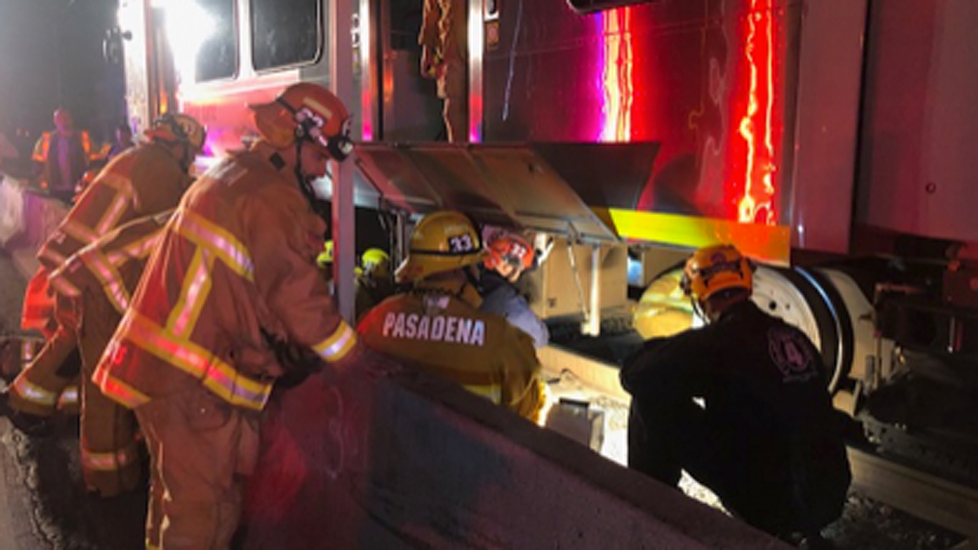Pasadena Fire Department personnel work to free a man from under a Gold Line train on Oct. 18, 2019. (Credit: Pasadena Fire Department)