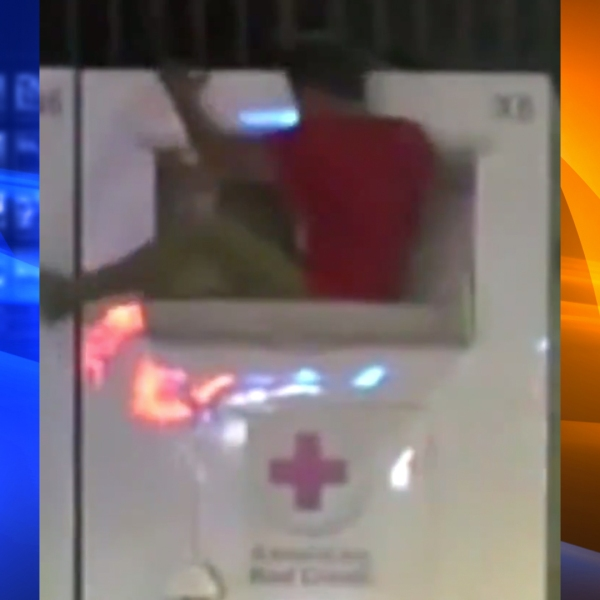 A flexible theft suspect was caught on camera climbing into a Red Cross donation box in Norwalk on Oct. 17, 2019. (Credit: Los Angeles County Sheriff's Department)