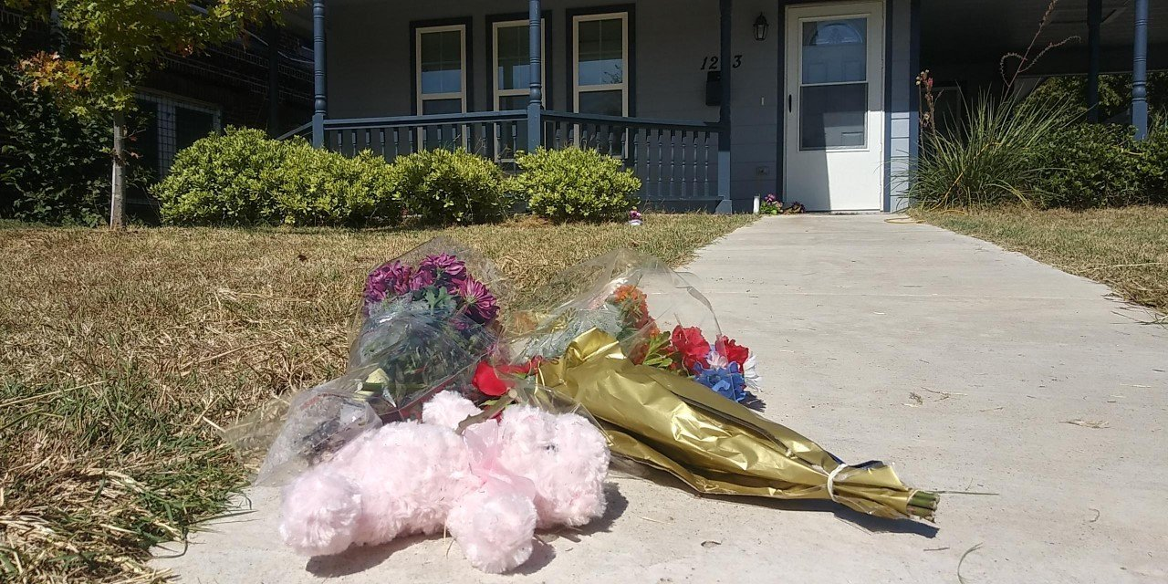 Flowers are laid out in front of Atatiana Jefferson's home on Oct. 13., 2019, after the 28-year-old was shot and killed by a white police officer in Fort Worth. (Credit: CNN)