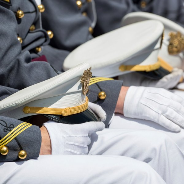 West Point cadets hold their caps on their laps during graduation ceremonies at the United States Military Academy, Saturday, May 25, 2019, in West Point, N.Y. (Credit: Julius Motal/AP via CNN Wire)