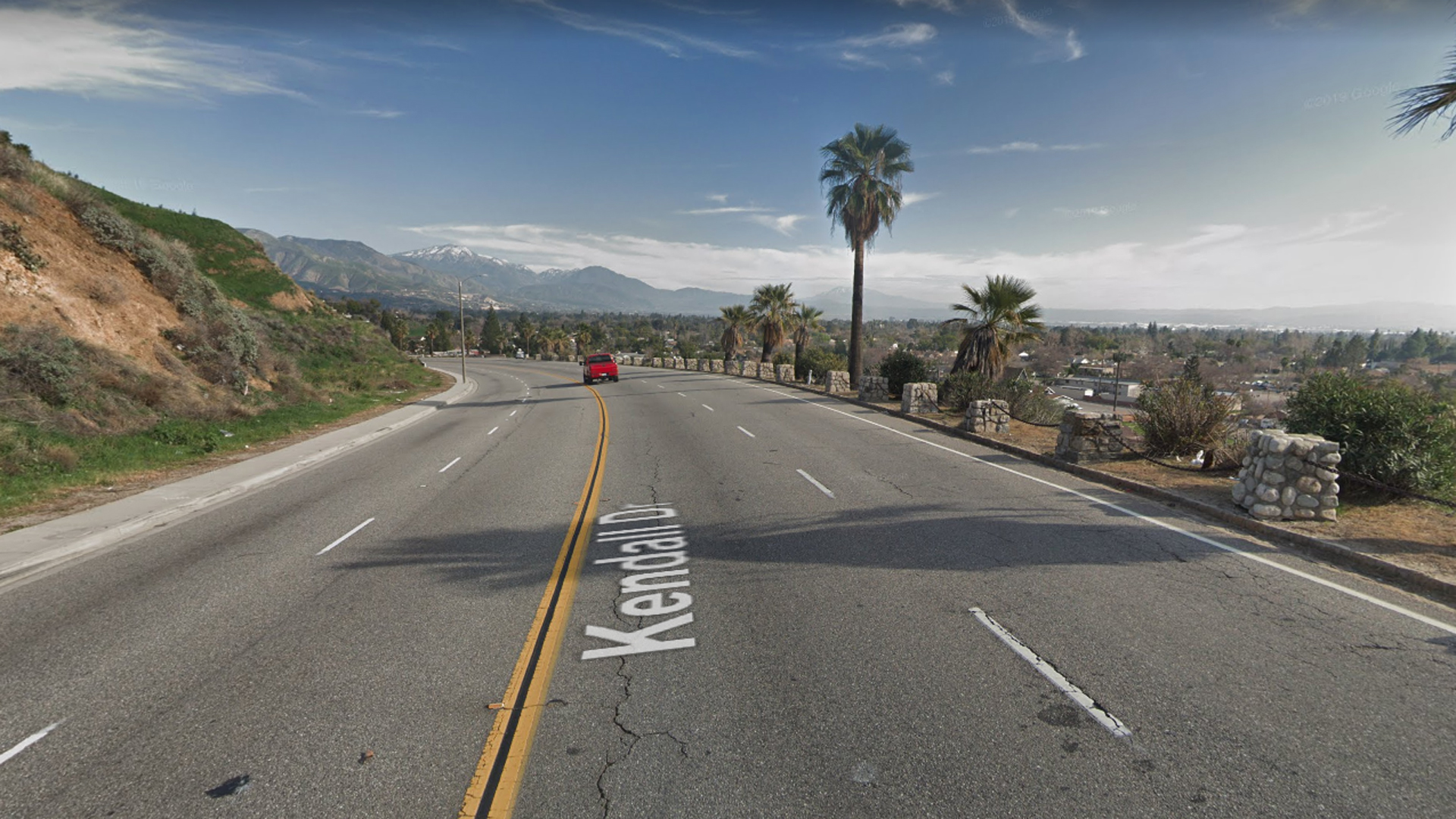 Eastbound Kendall Drive approaching E Street in San Bernardino, as viewed in a Google Street View image.