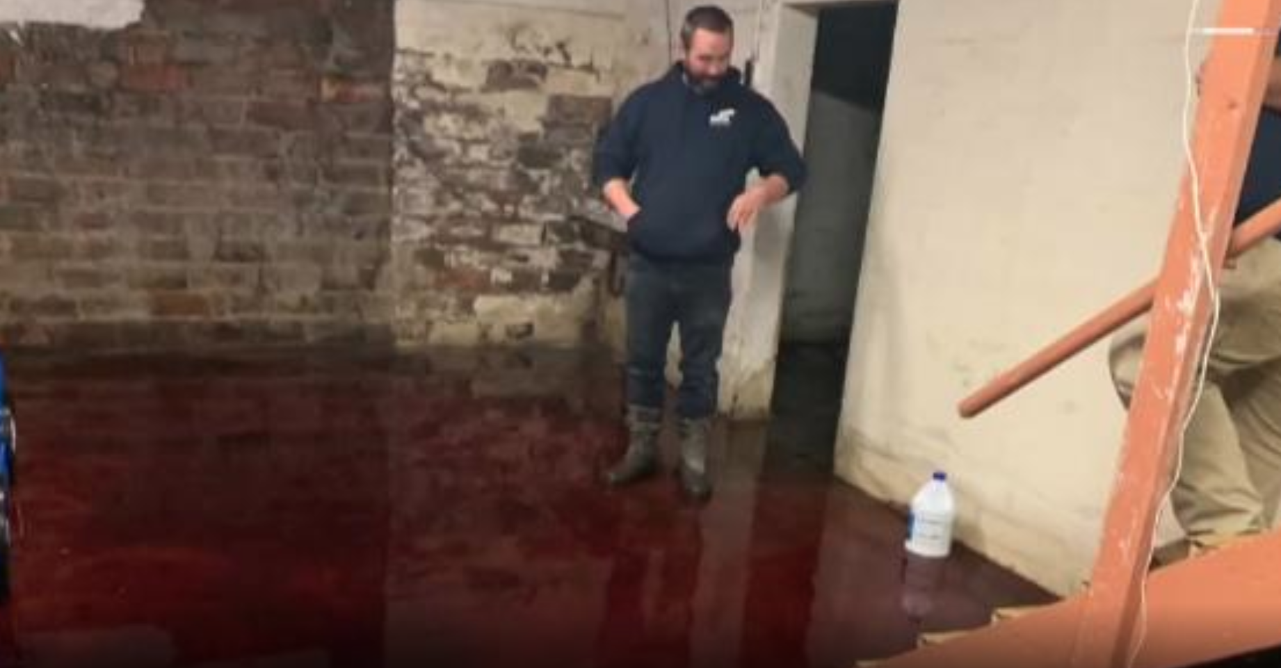A family's basement is flooded with blood that seeped in from a nearby slaughterhouse in Iowa. (Credit: WHO-DT via CNN)